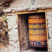 A tibetan Buddhist paryer wheel outside a village in the Solu region of Nepal.