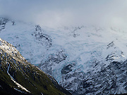 Clouds cover the top of Mt. Sefton and its icefall; Aoraki/Mt. Cook National Park, New Zealand