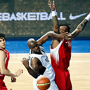 Efes Pilsen's Erwin DUDLEY (C) and Erdemir's James Dilliard THOMAS (R) during their Turkish Basketball league match Efes Pilsen between Erdemir at the Sinan Erdem  Arena in Istanbul Turkey on Saturday 29 January 2011. Photo by TURKPIX