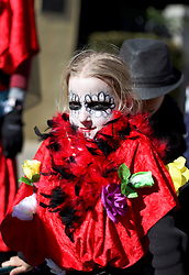 09 February 2016. New Orleans, Louisiana.<br /> Mardi Gras Day. Fiona Szapary in bright and colourful costume in the French Quarter. <br /> Photo©; Charlie Varley/varleypix.com