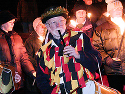 Pipe and Drummer,Wath Morris Man Bert Cleaver plays outside Wath Paris Church before the prosession  to Wath Town Square on Sunday Night as part of the Wath Fire Festival<br /><br />Sunday23-12-2001
