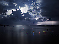 Night seascape with dramatic stormy sky and lightning on the horizon, Phan Thiet, Vietnam, Southeast Asia