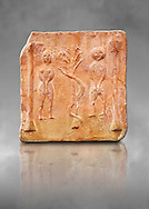 6th-7th Century Eastern Roman Byzantine  Christian Terracotta tiles depicting Adam & Eve with a serpent wrapped around a tree between them - Produced in Byzacena -  present day Tunisia. <br /> <br /> These early Christian terracotta tiles were mass produced thanks to moulds. Their quadrangular, square or rectangular shape as well as the standardised sizes in use in the different regions were determined by their architectonic function and were designed to facilitate their assembly according to various combinations to decorate large flat surfaces of walls or ceilings. <br /> <br /> Byzacena stood out for its use of biblical and hagiographic themes and a richer variety of animals, birds and roses. Some deer and lions were obviously inspired from Zeugitana prototypes attesting to the pre-existence of this province's production with respect to that of Byzacena. The rules governing this art are similar to those that applied to late Roman and Christian art with, in the case of Byzacena, an obvious popular connotation. Its distinguishing features are flatness, a predilection for symmetrical compositions, frontal and lateral representations, the absence of tridimensional attitudes and the naivety of some details (large eyes, pointed chins). Mass production enabled this type of decoration to be widely used at little cost and it played a role as ideograms and for teaching catechism through pictures. Painting, now often faded, enhanced motifs in relief or enriched them with additional details to break their repetitive monotony.<br /> <br /> The Bardo National Museum Tunis, Tunisia. Against a grey art background.