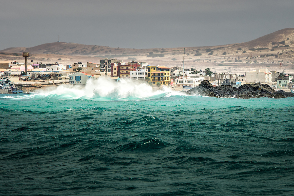 Huge waves crashing in front of the houses at Sal Rai, Boa Vista island, Cape Verde