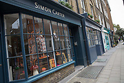 A fashion shop window along Lambs Conduit Street on 13th October 2015 in London, United Kingdom. Lambs Conduit Street is a street in Bloomsbury in the West End of London. There are many independent traders along the street