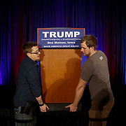 Workers remove the podium of Republican presidential candidate Donald Trump after speaking at the Sheraton in West Des Moines, Iowa, 01 February, 2016. The Iowa Caucus will be held 01 February 2016 and is the first official test of candidates seeing their parties nominations. EPA/JOHN TAGGART