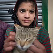 A teenage Hindu girl and her cat.