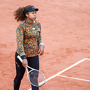 PARIS, FRANCE May 26. Naomi Osaka of Japan during practice on Court Philippe-Chatrier in preparation for the 2021 French Open Tennis Tournament at Roland Garros on May 6th 2021 in Paris, France. (Photo by Tim Clayton/Corbis via Getty Images)