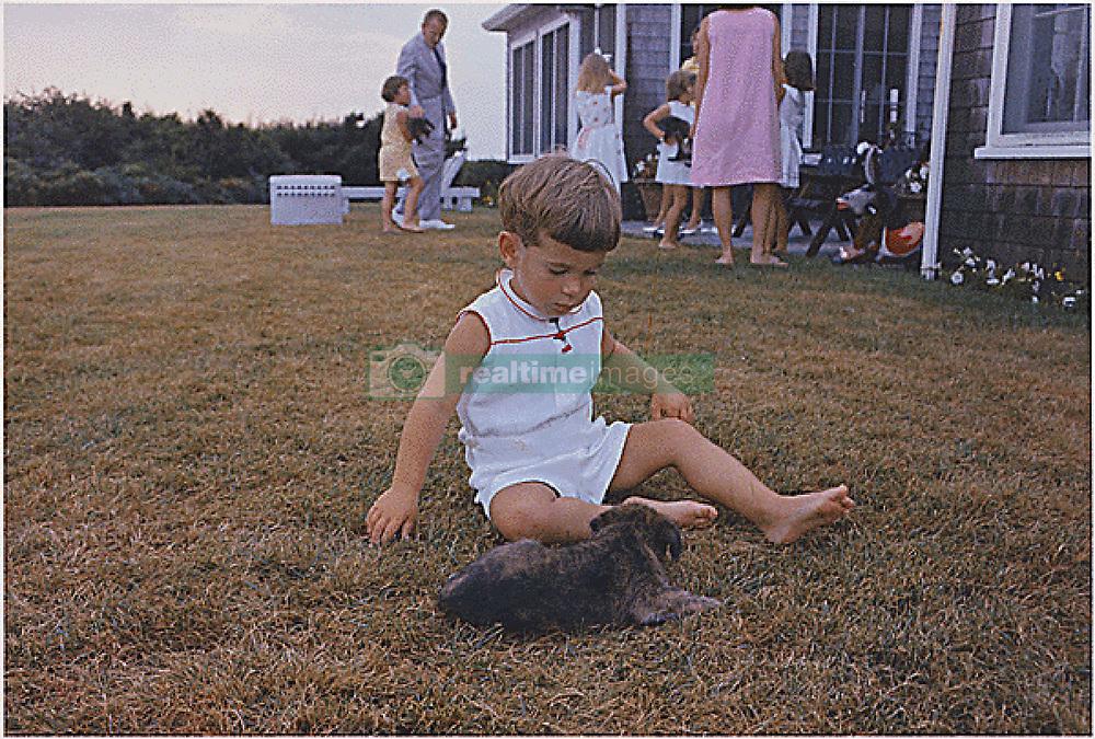 Nov. 20, 2013 - Hyannisport, Massachusetts, U.S - Hyannisport, MA, Squaw Island -- John F. Kennedy Jr. with puppy on August 3, 1963. (Credit Image: © Prensa Internacional/ZUMAPRESS.com)