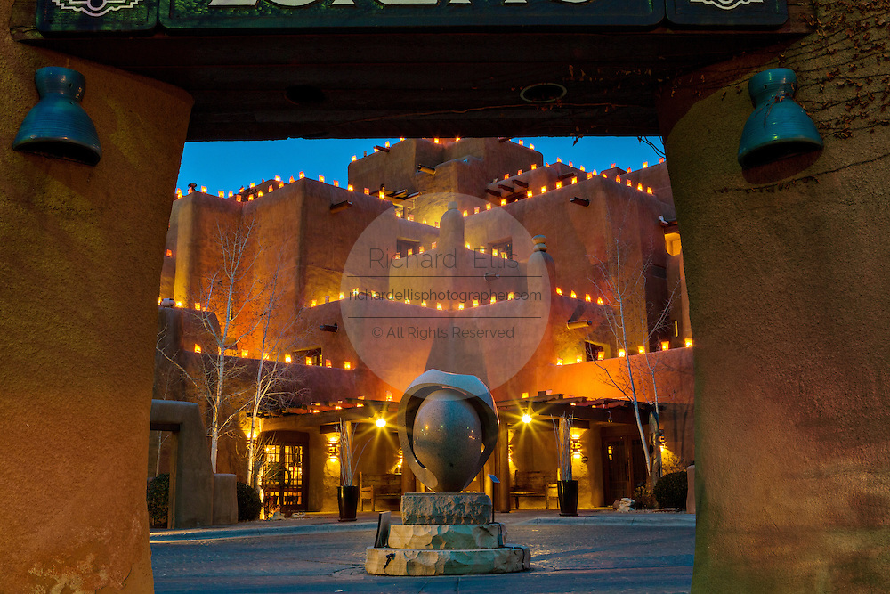 The adobe style Inn at Loretto is illuminated by hundreds of small paper lanterns known as luminaria to celebrate the holiday season in the historic district December 11, 2015 in Santa Fe, New Mexico.