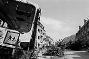 """Nardne Revolucje, the front line between Muslim East Mostar, and Croat West Mostar. It wasdestroyed by systemic bombardment from Croat guns during the Croat Muslim War, when the Croats endeavored to """" cleanse"""" the town of non Croats. Mostar, Bosnia and Herzegovina."""