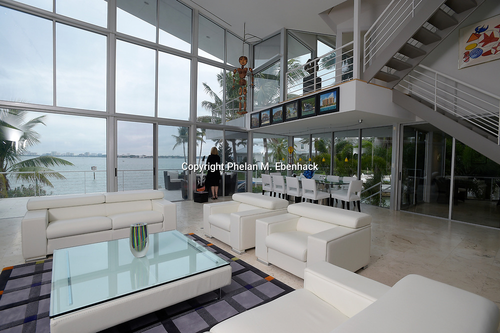 Large windows enclose the great room of the home of Dr. Joel Morganroth with a view of Sarasota Bay in Sarasota, Fla., Tuesday, Dec. 30, 2014. The home was designed to take advantage of the water view, where dolphins can be seen regularly swimming behind the house. (Photo by Phelan M. Ebenhack)