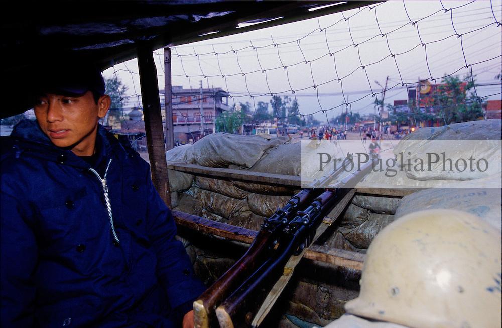 Nepalganj, 23 February 2005.  Armed policeman on the street of Nepalganj. During the last ten years, nearly 11,000 people have been killed in Nepal.