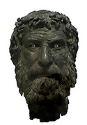 Portrait head from a statue of a philosopher. Bronze. Found on the Antikythera shipwreck. The head with the tousled hair, the luxuriant beard and thick moustache realistically depicts a philosopher with his individual features. The eyeballs made of different material and the irises of glass paste. Depicted standing, in his left hand he held a staff, and the right was extended in a characteristic gesture of orators. This statue depicted a Cynic philosophe, probably Bion the Boysthenite. About 240BC.