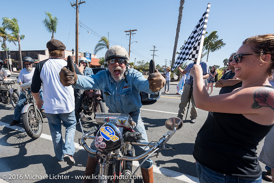 3,400 miles from the Atlantic to the Pacific - The journey is over. Frank Westfall of New York riding his 4-cylinder 1912 Henderson class-2 bike crosses the finish line of the Motorcycle Cannonball Race of the Century. Stage-15 ride from Palm Desert, CA to Carlsbad, CA. USA. Sunday September 25, 2016. Photography ©2016 Michael Lichter.