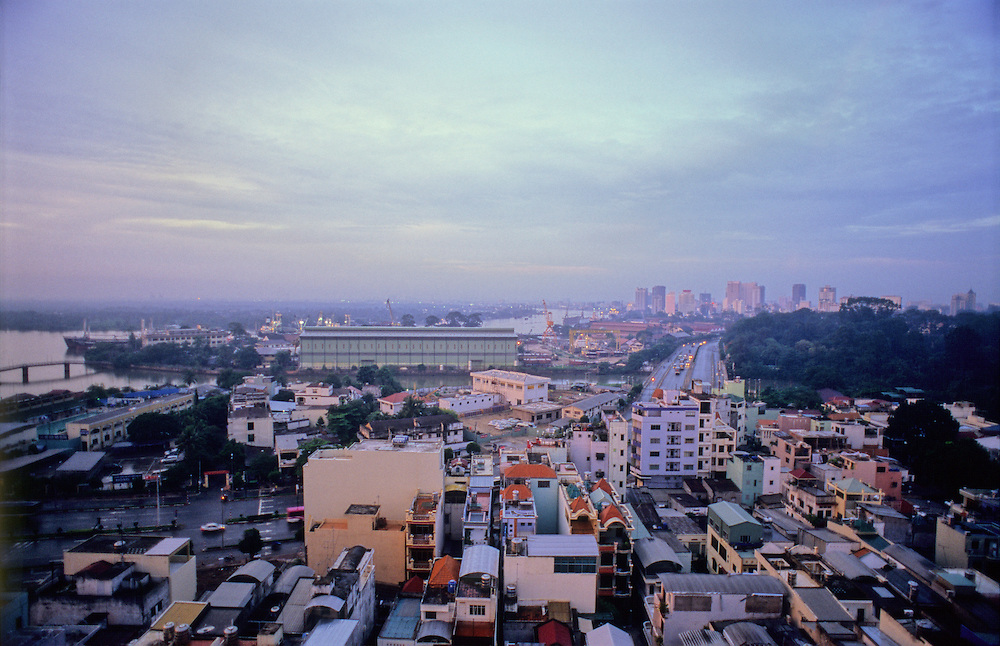 Business starts early in Vietnam. Just after sunrise in Ho Chi Minh City (Saigon) Vietnam the city wakes up.