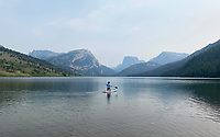 A paddleboarder floats into the Lower Green River Lake in the Wind River Mountains earlier this week beneath the skyline of Squaretop Mountain in the distance.