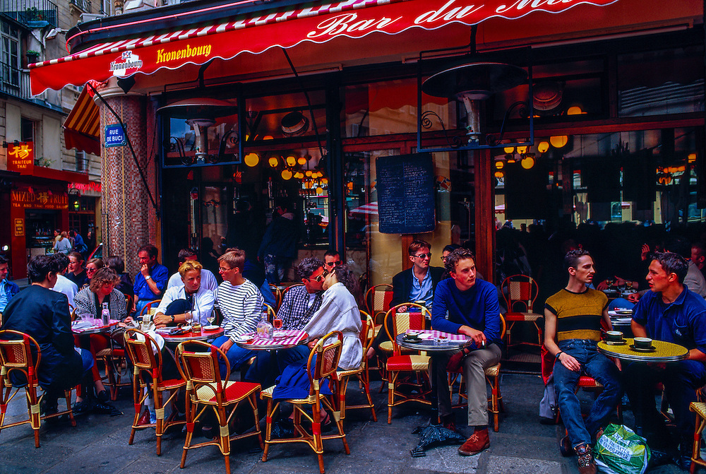 Lovers kissing at an outdoor cafe (Bar du Marche), Rue du Buci (Left Bank), Paris, France