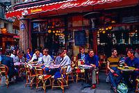 Lovers kissing at an outdoor cafe (Bar du Marche), Rue du Buci (Left Bank), Paris, France
