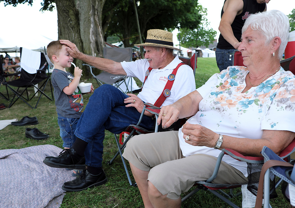 Four generations of the Miller family, led by 83-year-old patriarch Lester Miller, participate in American folk dancing demonstrations during the Kutztown Folk Festival, as they have for the past 40 years. The genuine charm of the Miller family comes not only from the dancing, but the efforts of a multi-generational family to uphold the traditions of the past while each new generation is born into a future that feels so much further from it.
