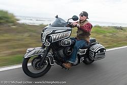 Indian ride through Tamoka State Park during Daytona Beach Bike Week. FL. USA. Monday March 13, 2017. Photography ©2017 Michael Lichter.