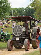 An antique steam tractor thrills the crowd during the daily parade at the Rock River Thresheree, Edgerton, Wisconsin; 2 Sept 2013