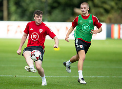 CARDIFF, WALES - Monday, August 31, 2020: Wales' Sion Spence (L) and Ryan Stirk (Birmingham City FC) (R) during a training session at the Vale Resort ahead of the UEFA Under-21 Championship Qualifying Round Group 9 match between Bosnia and Herzegovina and Wales. (Pic by David Rawcliffe/Propaganda)