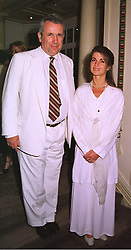 MR & MRS MARTIN BELL he is the independent MP for Tatton, at a party in London on 1st September 1998.MJN 17