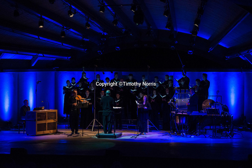 """Robert Spano (conductor) and Kevin Fox (choral director) lead the Ojai Festival Singers, soloists Rita Lily (soprano) and Clifton Massey (alto), and Steve Beck (celeste), Max Mandel (violin) and Joseph Gramley (percussion) in Morton Feldman's """"Rothko Chapel"""" at the 68th Ojai Music Festival at Libbey Bowl on June 14, 2014 in Ojai, California."""