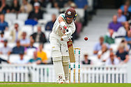 Wicket! Rory Burns of Surrey is bowled by Grant Stewart of Kent caught by Ollie Robinson of Kent during the Specsavers County Champ Div 1 match between Surrey County Cricket Club and Kent County Cricket Club at the Kia Oval, Kennington, United Kingdom on 7 July 2019.