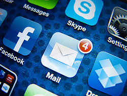 detail of iPhone 4G screen showing Google Mail app icon