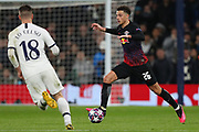 Defender Ethan Ampadu Of Leipzig runs with the ball at Midfielder Giovani Lo Celso of Tottenham during the UEFA Champions League match between Tottenham Hotspur and RB Leipzig, at The Tottenham Hotspur Stadium, Thursday, Feb. 20 2020,  in  London, United Kingdom. (Mitchell Gunn/Image of Sport)