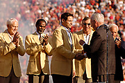 November 20, 2005, San Francisco, California, USA;  Steve Young of the San Francisco 49ers receives his Hall of Fame ring from Pro Football Hall of Fame Interim Executive Director Ron Dougherty at a halftime ceremony during the 49er-Seahawks game as 49er Hall of Famers Bill Walsh, Jimmy Johnson, and Dave Wilcox look on.