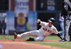 April 29, 2018 - San Francisco, CA, U.S. - SAN FRANCISCO, CA - APRIL 29: San Francisco Giants Catcher Buster Posey (28) Slide into second base durning the San Francisco Giants and Los Angeles Dodgers game at AT&T Park on April 29, 2018 in San Francisco, CA.  (Photo by Stephen Hopson/Icon Sportswire) (Credit Image: © Stephen Hopson/Icon SMI via ZUMA Press)