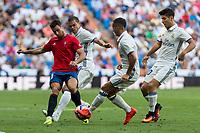 Club Atletico Osasuna's Jaime Romero and Real Madrid's Pepe Lucas Vazquez and Avlaro Morata during the match of La Liga between Real Madrid and Club Atletico Osasuna at Santiago Bernabeu Estadium in Madrid. September 10, 2016. (ALTERPHOTOS/Rodrigo Jimenez)