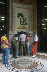 Tourists using cash point of the Bank of Novia Scotia in Havana; Cuba,