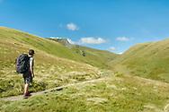 Entering the secretive Glendermackin valley, the razor-edged Sharp Edge begins to dominate the far landscape