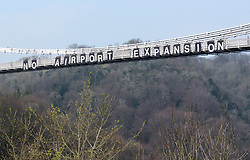 © Licensed to London News Pictures. 07/04/2019. Bristol, UK. Campaign group Extinction Rebellion protest with banners at the Clifton Suspension Bridge against airport expansion. The protest is against plans to increase passengers using Bristol Airport from 8 million to 12 million by 2026. Photo credit: Simon Chapman/LNP