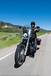 Tammy Bachofner of Chandler, AZ on her 2015 Dyna Wide riding from Steamboat Springs to Doc Holliday's Harley-Davidson in Glenwood Springs, Colorado, USA. Thursday June 8, 2017. Photography ©2017 Michael Lichter.
