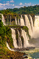 Iguazu Falls (Iguacu in Portugese), on the border of Brazil and Argentina. It is one of the New 7 Wonders of Nature and is a UNESCO World Heritage Site. There are 275 waterfalls total which make up the largest waterfalls in the world. (taken from Argentina side)
