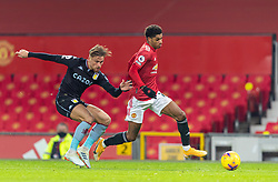MANCHESTER, ENGLAND - Friday, January 1, 2020: Manchester United's Marcus Rashford (R) gets away from Aston Villa's Matthew Cash during the New Year's Day FA Premier League match between Manchester United FC and Aston Villa FC at Old Trafford. The game was played behind closed doors due to the UK government putting Greater Manchester in Tier 4: Stay at Home during the Coronavirus COVID-19 Pandemic. (Pic by David Rawcliffe/Propaganda)