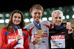 Second placed Anna Chicherova of Russia, winner Blanka Vlasic of Croatia and third placed Ariane Friedrich of Germany celebrate at the medal ceremony after the women's High Jump Final during day six of the 12th IAAF World Athletics Championships at the Olympic Stadium on August 20, 2009 in Berlin, Germany. (Photo by Vid Ponikvar / Sportida)