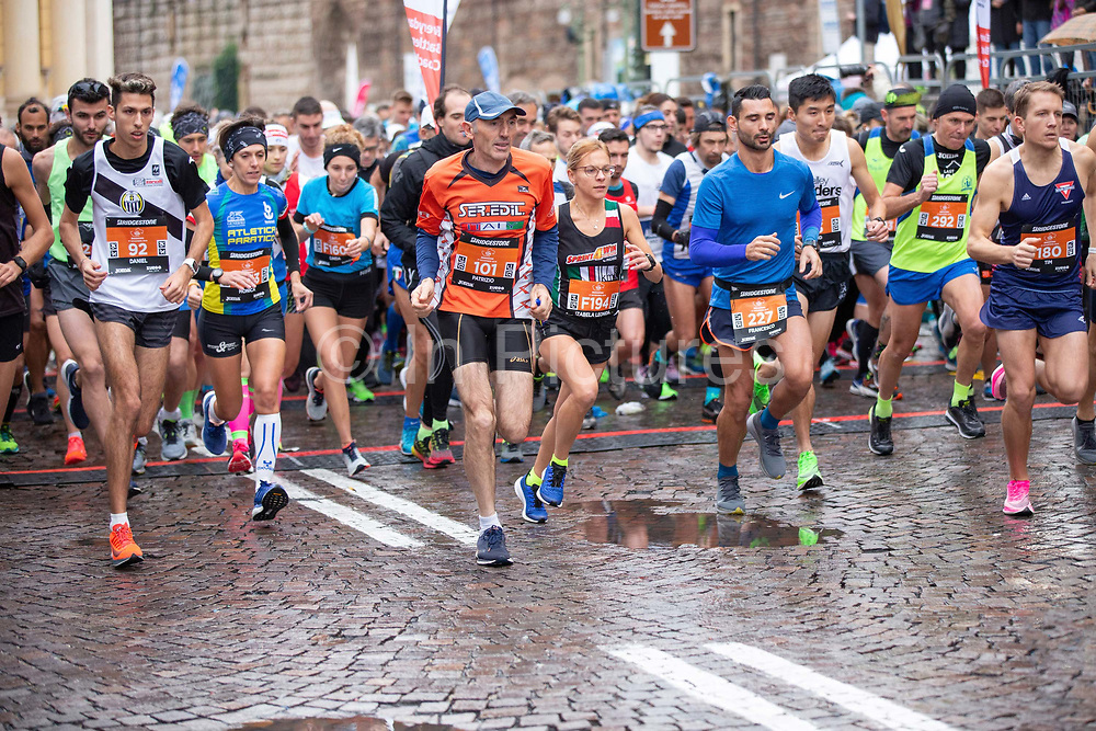 Runners setting off from the start line during the Verona Marathon on the 17th November 2019 in Verona in Italy.