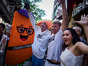 24 JANUARY 2019 - BANGKOK, THAILAND:  Expats in Bangkok cheer during the grand opening festivities of the the first Taco Bell in Thailand, which opened Thursday. The restaurant has a 215 square meter space in the Mercury Ville, a mixed use retail/office building in central Bangkok. Taco Bell is owned by Yum Brands, which also owns KFC, Pizza Hut, and WingStreet. Taco Bell in Thailand joins KFC, which has more than 500 restaurants in Thailand and Pizza Hut, which recently started expanding in Thailand.  PHOTO BY JACK KURTZ