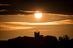 © Licensed to London News Pictures. 24/06/2015. Whitley Bay.UK. Picture shows the sun rising over the village of Earsdon. Forecasters are predicting a dry but cloudy day with sunny spells this morning. Photo credit : Andrew McCaren/LNP