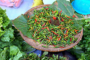 Fresh red and green chillies for sale at an early morning market in Loikaw on 17th January 2016 in Kayah state, Myanmar.  A large variety of local products are available for sale in fresh markets all over Myanmar, all being sold on small individual stalls