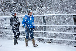 © Licensed to London News Pictures. 24/01/2021. Wendover, UK.  People walking as heavy snow falls in the Chilterns. The Met office has issued a yellow warning for snow covering most of the south of England until 23:59 tonight.   Photo credit: Cliff Hide/LNP