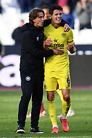 Football - 2021 / 2022  Premier League - West Ham United vs Brentford - The London Stadium - Sunday 3rd October 2021<br /> <br /> Brentford manager Thomas Frank with Christian Norgaard at the final whistle.<br /> <br /> COLORSPORT/Ashley Western