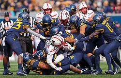 Nov 9, 2019; Morgantown, WV, USA; Texas Tech Red Raiders wide receiver Erik Ezukanma (84) is tackled by many West Virginia Mountaineers defenders during the first quarter at Mountaineer Field at Milan Puskar Stadium. Mandatory Credit: Ben Queen-USA TODAY Sports