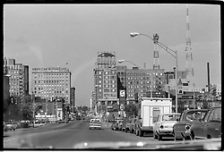 Des Moines Iowa, Grand Avenue, Heading west in the Summer of 1973. Downtown View, shot through the car window on Tri-X B&W film.